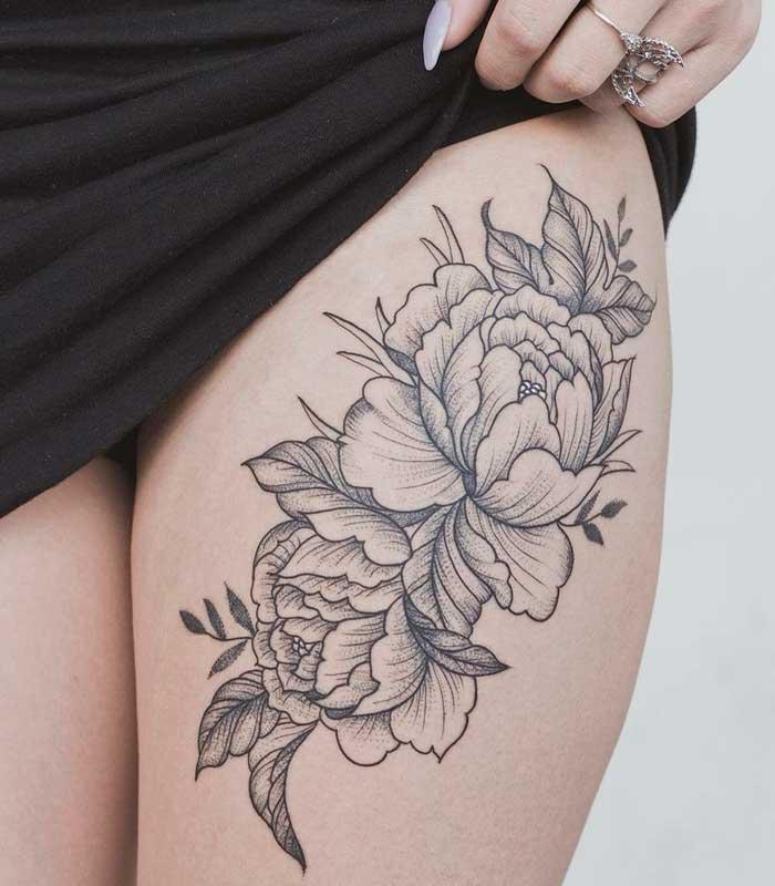 tatuajes de flores en la pierna